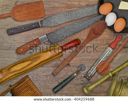 vintage bakery shop tools and utensils over stained wooden table - stock photo