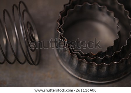 Vintage  Baking Tin cutters and whisk, , tiny focus - stock photo
