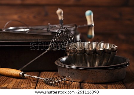 Vintage  Baking Tins and tools on wooden background - stock photo