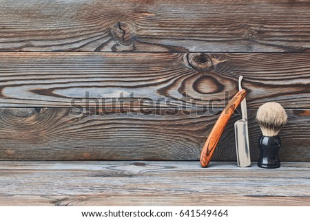 Vintage barber shop tools on old wooden background with copy space