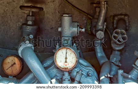 Vintage barometer and fire protection system in the truck. - stock photo
