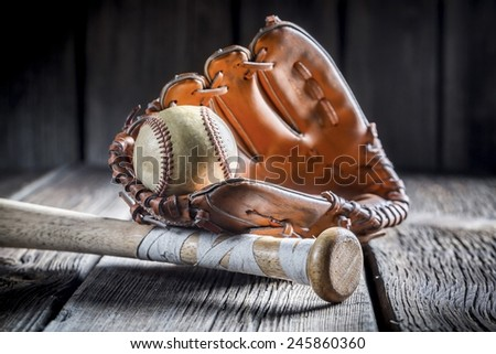 Vintage baseball ball and golden glove - stock photo