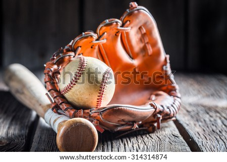 Vintage Baseball in a leather glove - stock photo