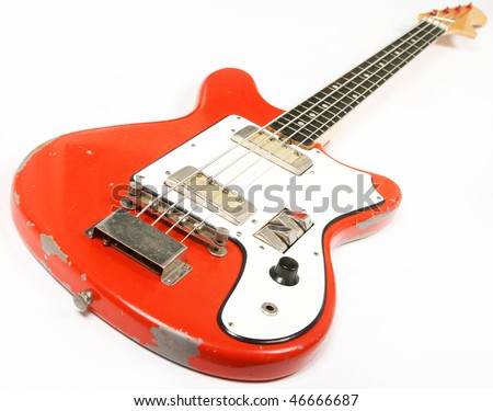 Vintage bass guitar isolated on white background