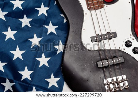 Vintage bass guitar on an american flag background. selective focus