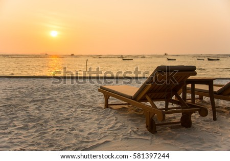 vintage beach chairs in sunset