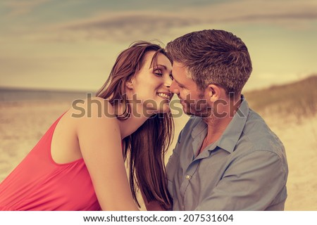 vintage beach scene of younger adults - stock photo