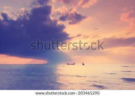 Vintage beach sunset with long tail boat floating,Samui Thailand