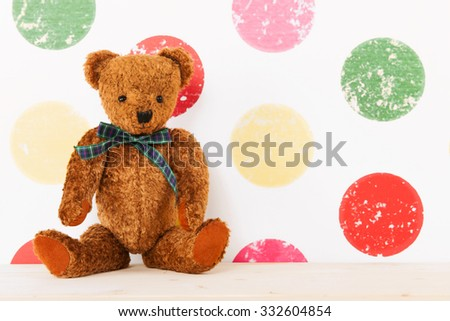 vintage bear in colorful nursery room - stock photo