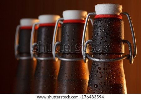 Vintage beer bottles with swing top macro - stock photo