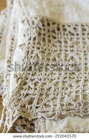 Vintage Beige tablecloth with crochet lace - stock photo