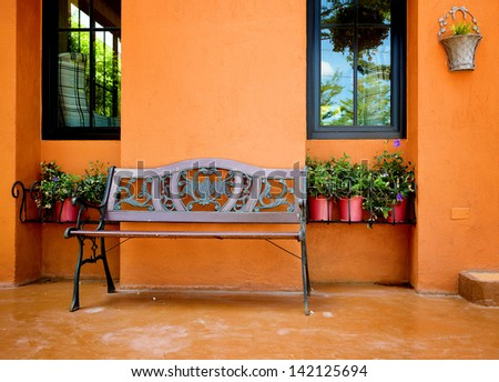 Vintage bench at front house - stock photo