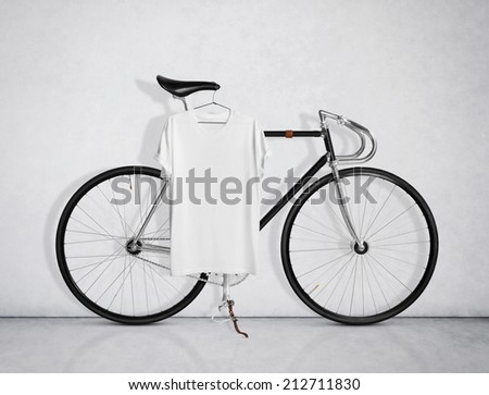 Vintage bicycle and blank t-shirt - stock photo