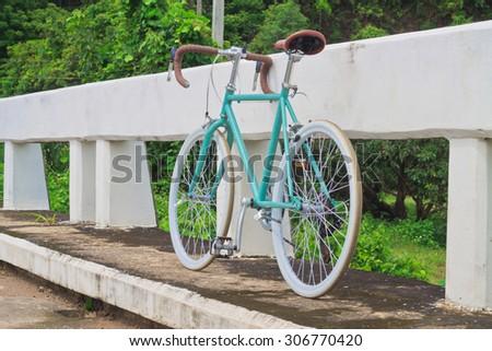 Vintage Bicycle Bridge nature park. - stock photo