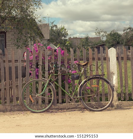 Vintage bicycle near old fence