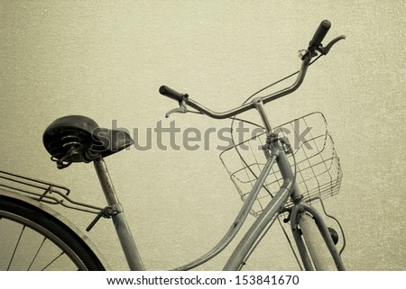 vintage bicycle old background - stock photo