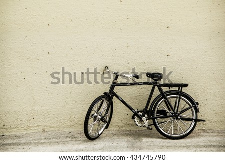 Vintage bicycle on old walls