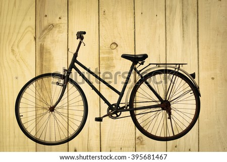 vintage bicycle on wooden texture.