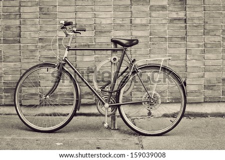 Vintage bicycle parked on the street in Toronto - stock photo