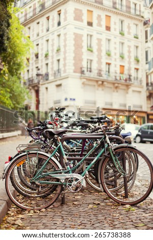 vintage bicycle parking at the street - stock photo