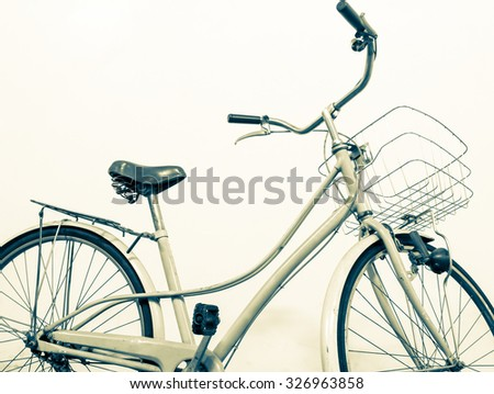 vintage bicycle white background, vintage color style - stock photo