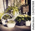 Vintage bicycle with flowers on the basket - stock photo