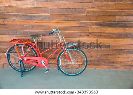 Vintage bicycle with wooden wall, Thailand.