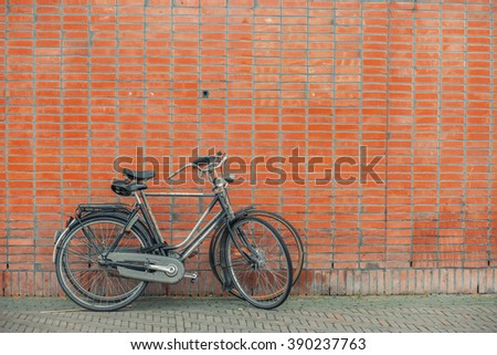 Vintage bicycles on brick wall background.