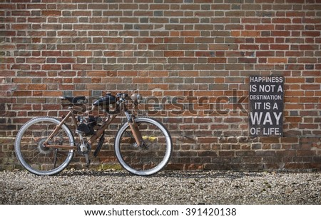 vintage bike against wall - stock photo