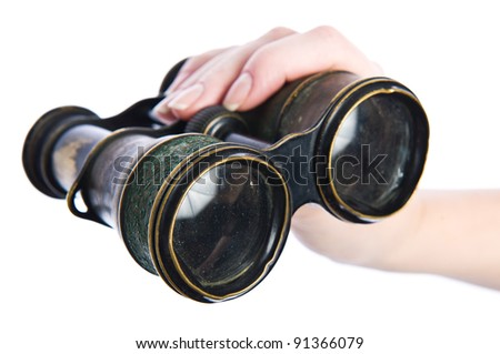 Vintage binocular in woman's hand, isolated on white