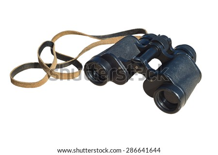 Vintage binoculars on the background of cut