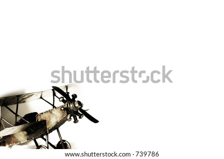 Vintage biplane replica with shadow on white - transportation and travel. - stock photo