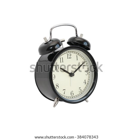 Vintage black alarm clock isolated on white background with clipping path