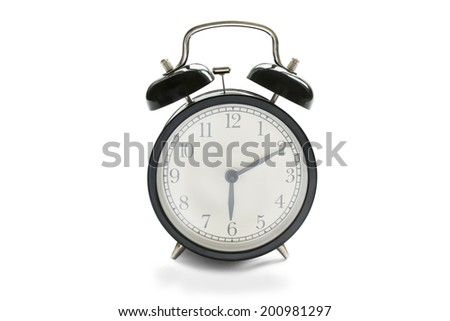 Vintage black alarm clock isolated over white