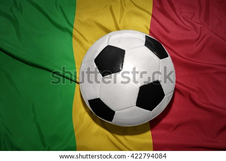 vintage black and white football ball on the national flag of mali
