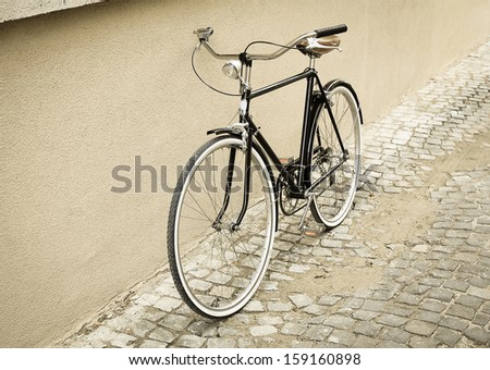 vintage black bike on a street - stock photo