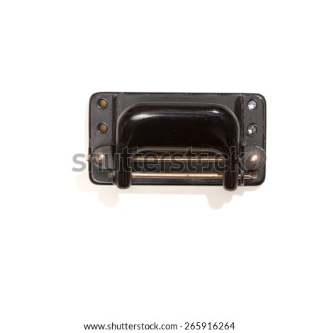 Vintage black perforator or hole-puncher, top view, isolated on white. - stock photo