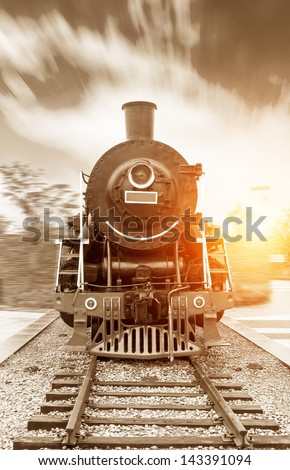 vintage black steam powered railway train - stock photo