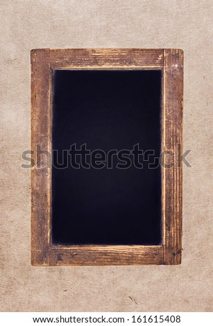 Vintage blackboard on textured  background. Blank Chalk board with copy space  - stock photo