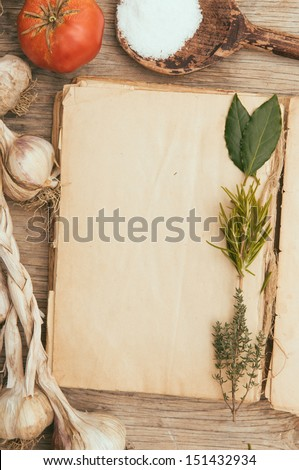 Vintage blank cookbook and mediterranean food - stock photo