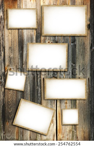 Vintage blank photo frames on wooden background - stock photo
