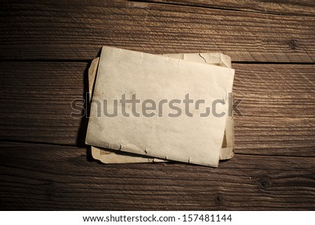Vintage blank photo on wooden background