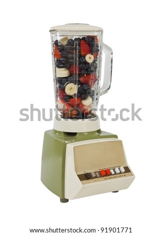 Vintage blender with blueberry, strawberry, banana smoothie mix. - stock photo