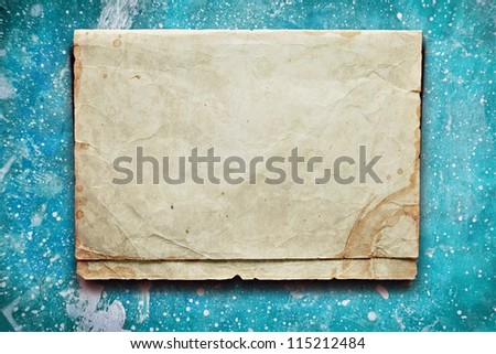 Vintage blue background with old paper and coffee stain - stock photo