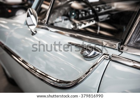 Vintage blue car with chrome detail in a salon