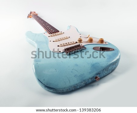 Vintage blue guitar with worn and battered lacquer finish