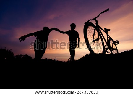 Vintage blurry photo of Wide moving silhouettes of two boys holding hands. - stock photo