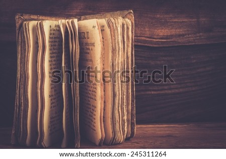Vintage book on a wooden background  - stock photo
