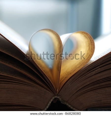 Vintage book pages, heart shaped - stock photo