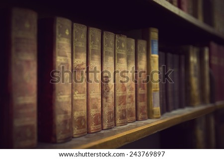 Vintage books in book case in library